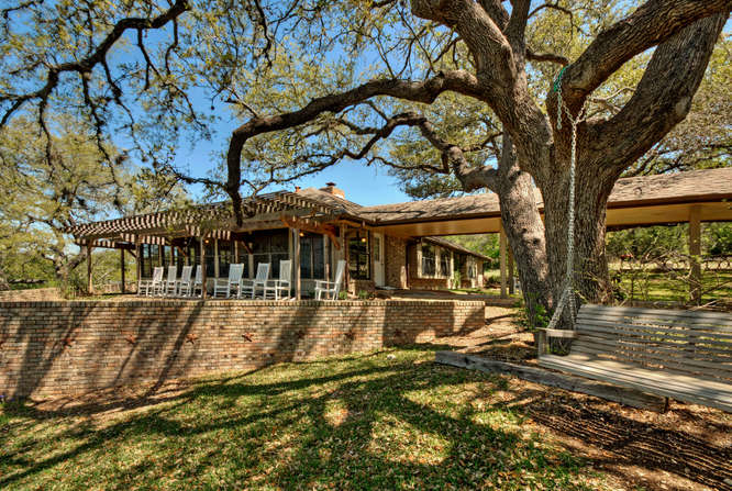 still-waters-retreat-center-9409-granada-austin-texas-felder-house-swing-and-porch